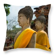 Two Buddha Statues Wrapped In An Orange Scarf  Throw Pillow