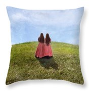 Two Girls In Vintage Dresses Walking Up Grassy Hill Throw Pillow