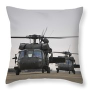 Two Uh-60 Black Hawks Taxi Throw Pillow by Terry Moore