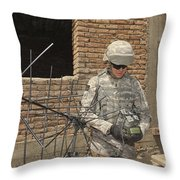 U.s. Army Soldier Configures Throw Pillow