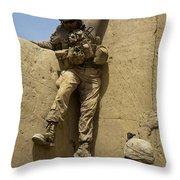 U.s. Marine Climbs Down From An Throw Pillow