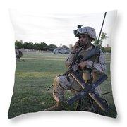 U.s. Marine Utilizes A Satellite Radio Throw Pillow