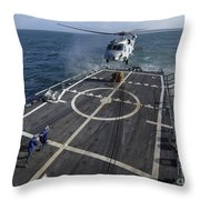 U.s. Navy Sailors Prepare To Attach Throw Pillow