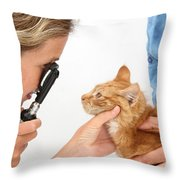 Vet Examining Kitten Throw Pillow
