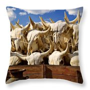 Wagon Full Of Animal Skulls Throw Pillow by Garry Gay