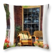 Wicker Chair With Striped Pillow Throw Pillow