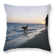 Woman And Dog Running On Beach, Nags Throw Pillow