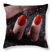 Woman Hand With Red Nail Polish Buried In Black Sand Throw Pillow