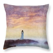 Woman In Vintage Dress At The Rocky Shore At Dawn Throw Pillow