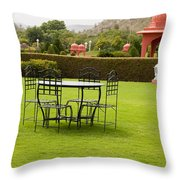 Wrought Metal Chairs Around A Table In A Lawn Throw Pillow