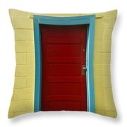 Yellow Wall And Red Door Throw Pillow