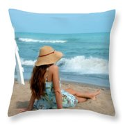 Young Woman Sitting On A Beach Throw Pillow