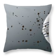 A Dirty White Leather Cricket Ball Caught In Slow Motion Flying Through The Air Scattering Dirt Part Throw Pillow