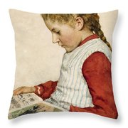 A Girl Looking At A Book Throw Pillow