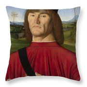 A Man With A Pink Throw Pillow