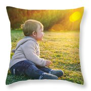 Adorable Baby Playing Outdoors Throw Pillow