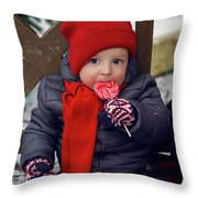 Baby In Red Hat Sits On A Bench In The Street With Candy Throw Pillow
