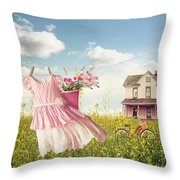 Child's Dress And Toys Hanging On Line With Farmhouse In Backgro Throw Pillow