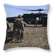 Green Berets Move A Simulated Casualty Throw Pillow