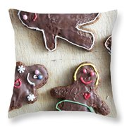 Handmade Decorated Gingerbread People Lying On Wooden Table Throw Pillow