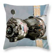 Iss Expedition 11 Crew Arriving Throw Pillow by NASA / Science Source