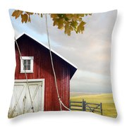 Large Red Barn With Bicycle In Field Of Wheat Throw Pillow