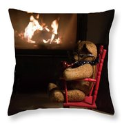 Old Teddy Bear Sitting Front Of The Fireplace In A Cold Night Throw Pillow