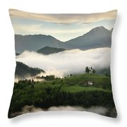 Rolling Fog At Sunrise In The Skofjelosko Hills With St Thomas C Throw Pillow