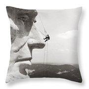 Scaling Mount Rushmore Throw Pillow by Granger