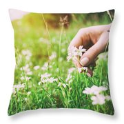Woman Picking Up Flowers On A Meadow, Hand Close-up. Vintage Light Throw Pillow