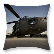 A Uh-60l Blackhawk Parked On Its Pad Throw Pillow