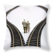 Figurines Between Two Tracks Leading Into Different Directions Symbolic Image For Making Decisions. Throw Pillow
