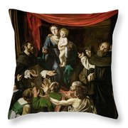 Madonna Of The Rosary Throw Pillow by Caravaggio