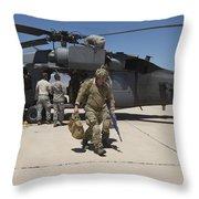 Pararescuemen Walks Away From A Hh-60g Throw Pillow