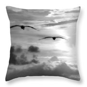2 Pelicans Flying Into The Clouds Throw Pillow