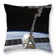 The Spacex Dragon Cargo Craft Throw Pillow by Stocktrek Images