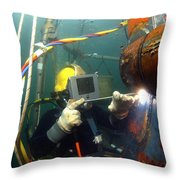 U.s. Navy Diver Welds A Repair Patch Throw Pillow by Stocktrek Images