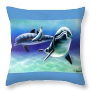 3 Dolphins Throw Pillow