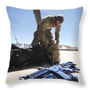 Pararescuemen Sorts Out His Gear Throw Pillow