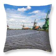 Traditional Dutch Windmills At Zaanse Schans, Amsterdam Throw Pillow