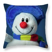 A Cute Little Soft Snowman With A Blue Hat And A Colorful Scarf Throw Pillow