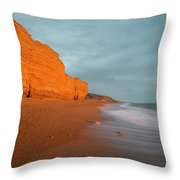 Beautiful Vibrant Sunset Landscape Image Of Burton Bradstock Gol Throw Pillow