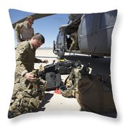 Pararescuemen Sorts Out His Gear Throw Pillow