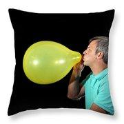 Man Inflating Balloon Throw Pillow