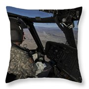 Pilot Operating The Cockpit Of A Uh-60 Throw Pillow