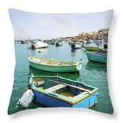 Traditional Boats At Marsaxlokk Harbor In Malta Throw Pillow