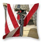 A Battlefield Memorial Cross Rifle Throw Pillow by Stocktrek Images
