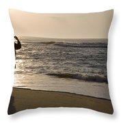 A Beach Walker Photographs Sunrise Throw Pillow