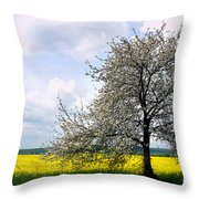 A Blooming Tree In A Rapeseed Field Throw Pillow