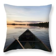 A Boat And Paddle On A Tranquil Lake Throw Pillow